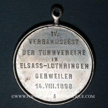 Coins Guebwiller. 4e tournoi de gymnastique des associations d'Alsace et de Lorraine 1898. Médaille alu.